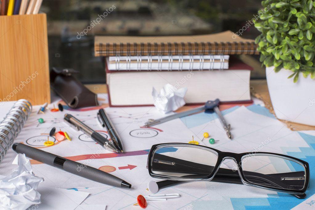 Messy office table with financial report Stock Photo peshkova