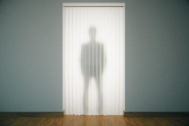 Man silhouette behind curtains