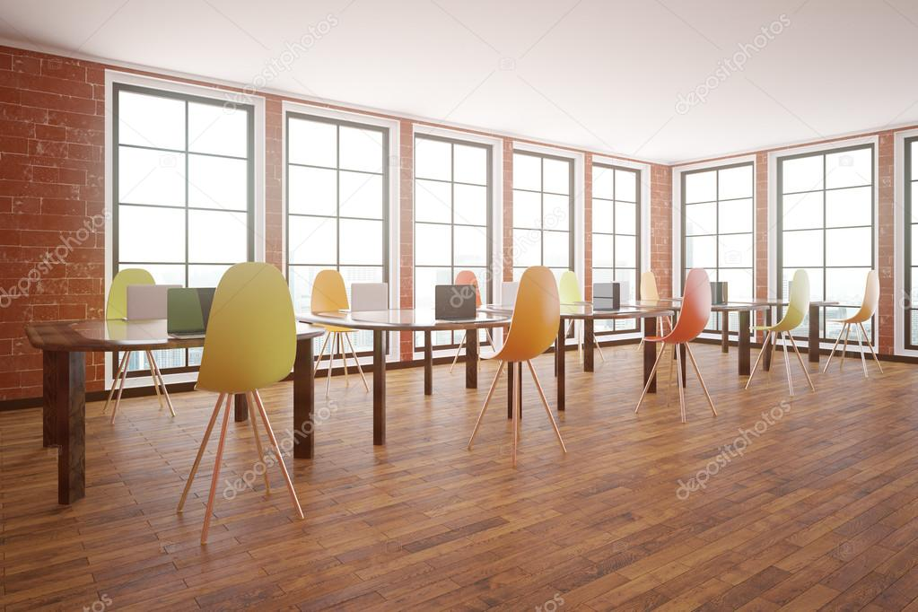 Red Brick Interior With Wooden Floor Windows With City View And Tables With Chairs Classroom Concept Side View 3d Rendering Stock Photo Image By C Peshkova 128003932