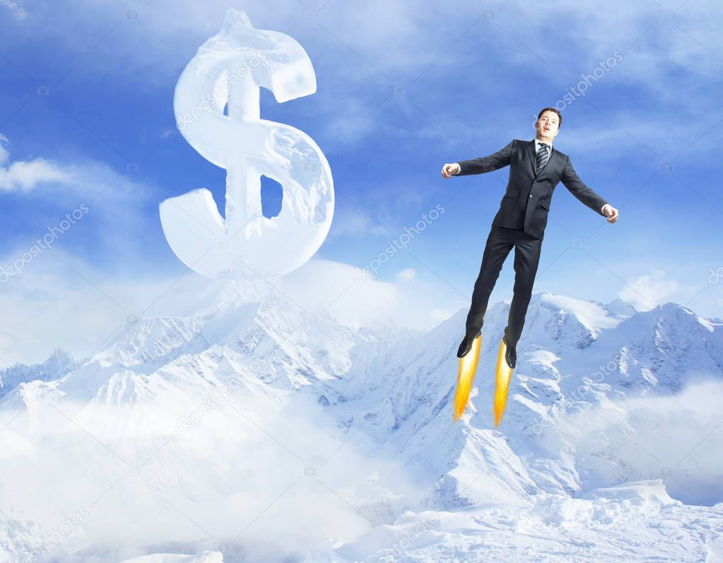 Young superman flying in bright blue sky with creative dollar sign young superman flying in bright blue sky with creative dollar sign above snowy mountains success publicscrutiny Images