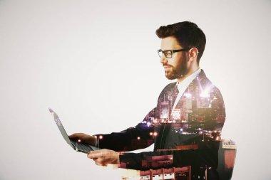Man using laptop multiexposure
