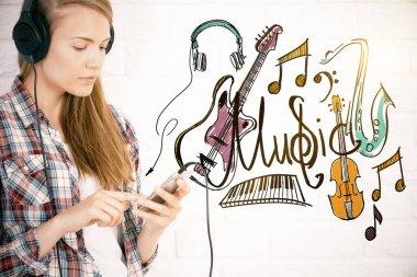Caucasian girl listening to music