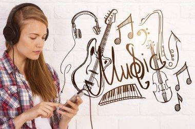 European girl listening to music