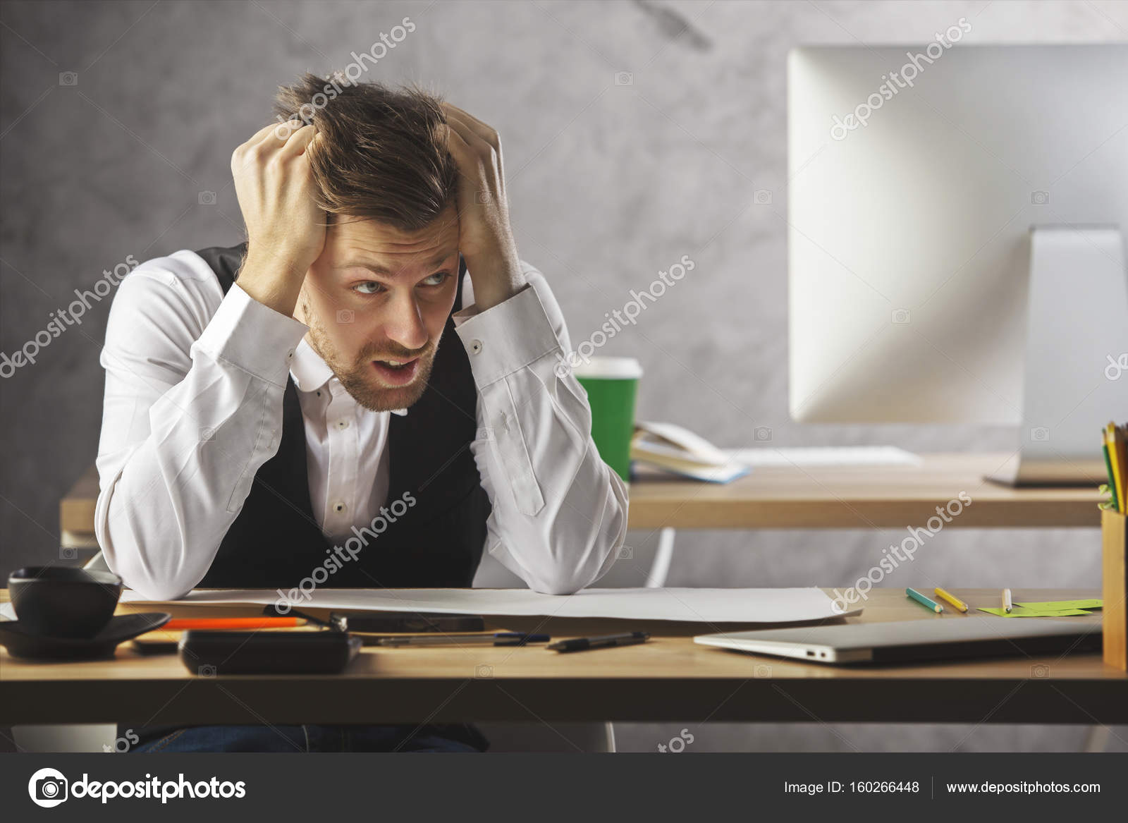 european cup office coffee. Stressed Young European Businessman At Workplace With Computer, Supplies, Coffee Cup And Other Items Office T