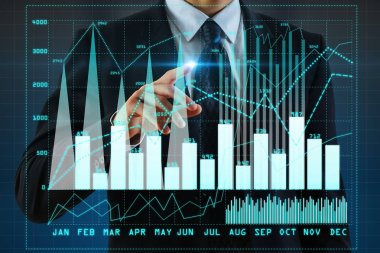 Unrecognizable businessman pointing at business chart on blurry blue background. Interface concept. Double exposure