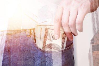 Man putting money in pocket