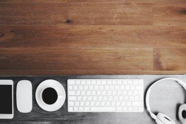 Wooden desktop with headphones and coffee
