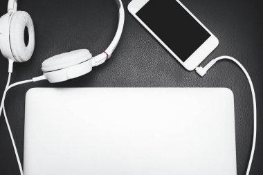 Smartphone, laptop and headphones