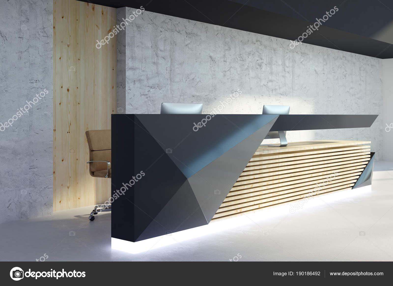 Illuminated Reception Desk In Modern Interior Side Stock Photo