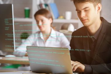 Man using laptop with html code