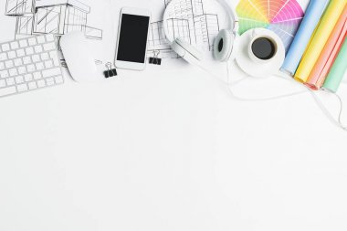 Creative desk with devices and supplies