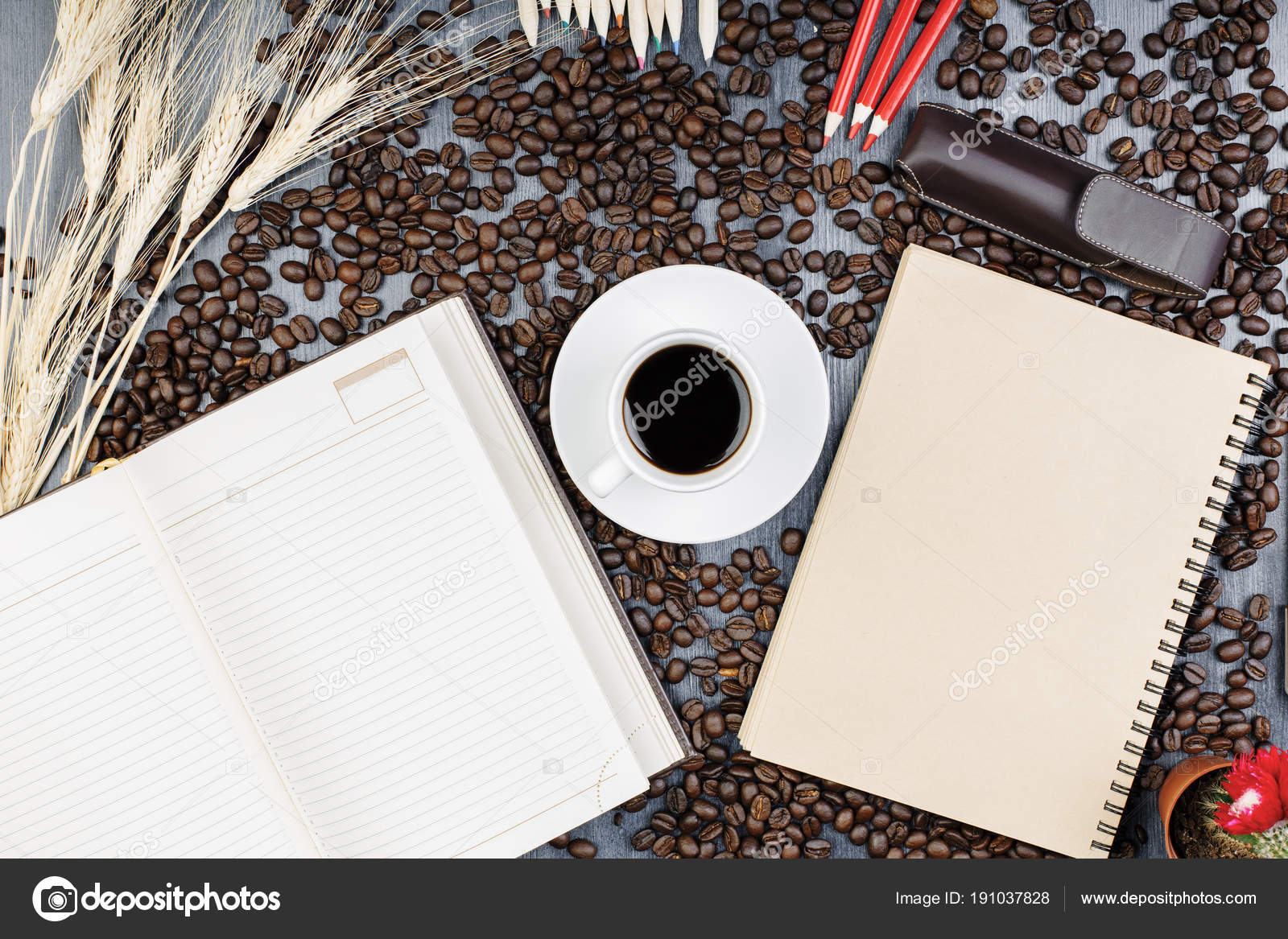 Modern table with notepad and coffee — Stock Photo