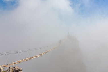 Man in fog over chasm