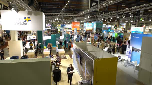 A lot of people in the large international fair of travel agencies