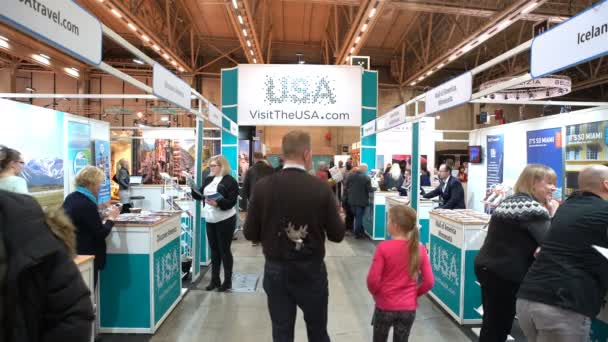 A lot of people at the pavilion Visit The America on the large international fair of travel agencies