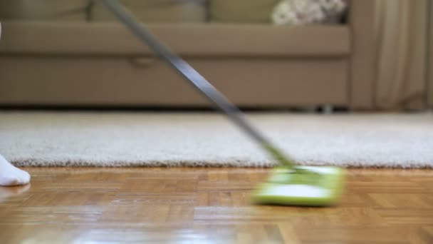 Woman Cleaning Parquet Floors In The Living Room Close Up Stock