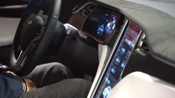 The interior of a Tesla Model X electric car with large touch screen ...