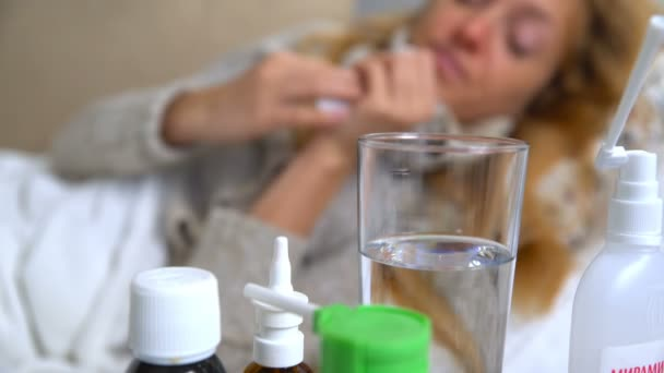 A Woman With Fever Uses Nasal Spray And Sneezes.
