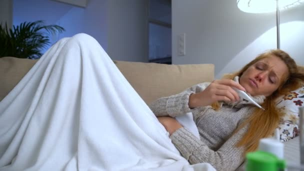A Woman With Fever Lying On The Couch With A Thermometer In His Mouth. Dolly.