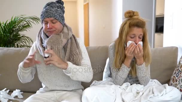 Ailing Pair With Runny Nose Using Nasal And Throat Spray Sitting In Living Room.