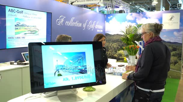 Fans of outdoor activities choose tours in a travel agency.
