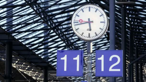 Watch on a platform of the railway station in Helsinki, Finland. Time Lapse.