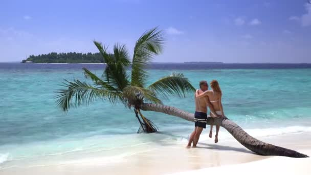 A loving couple enjoying vacation on a tropical beach.