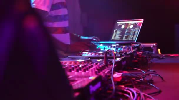 Hands Of Female Dj Playing Set Performing At Party In Night Club
