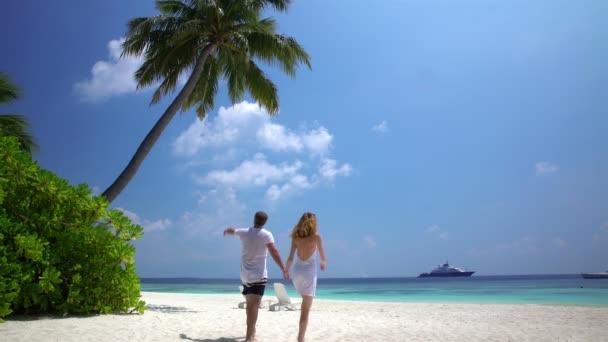A loving couple enjoying vacation on the tropical beach.