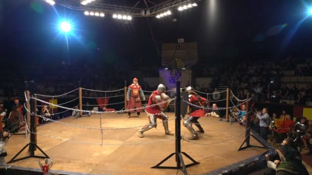 Two Medieval Knight Fighting In An Arena With Swords And Shields.