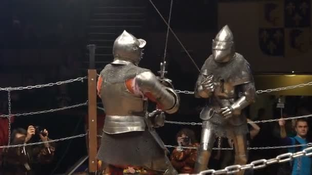 Two Medieval Knight Fighting In The Arena With Two-Handed Swords. Slow Motion.