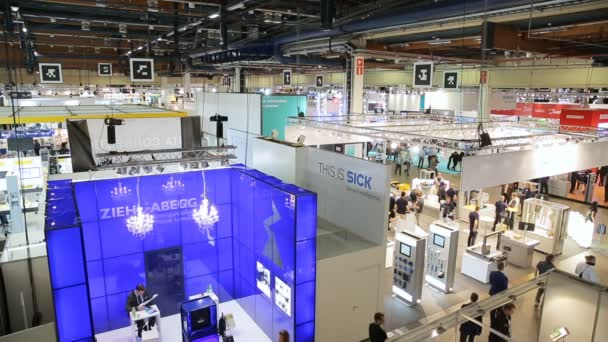 A Lot of people in technology exhibition.