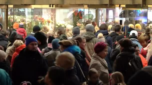 A huge crowd of buyers in front of mall during total Christmas sales.