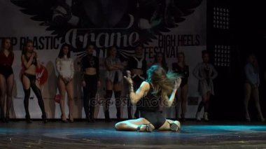 A girl performs an erotic dance on the stage.