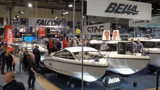 International Boat Show. Visitors inspect boats of different models and prices.