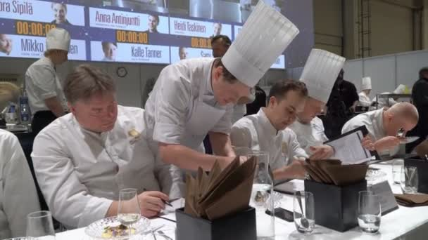 Contest Chef of the Year in Helsinki. The jury trying the dessert.