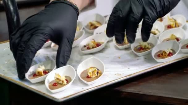 The chefs prepare food samples and treat visitors