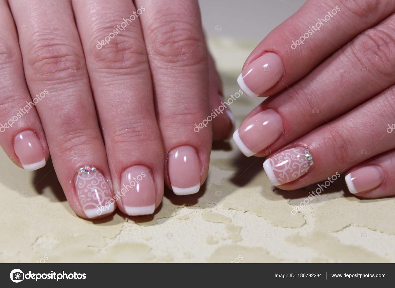 White French manicure design — Stock Photo © SmirMaxStock #180792284