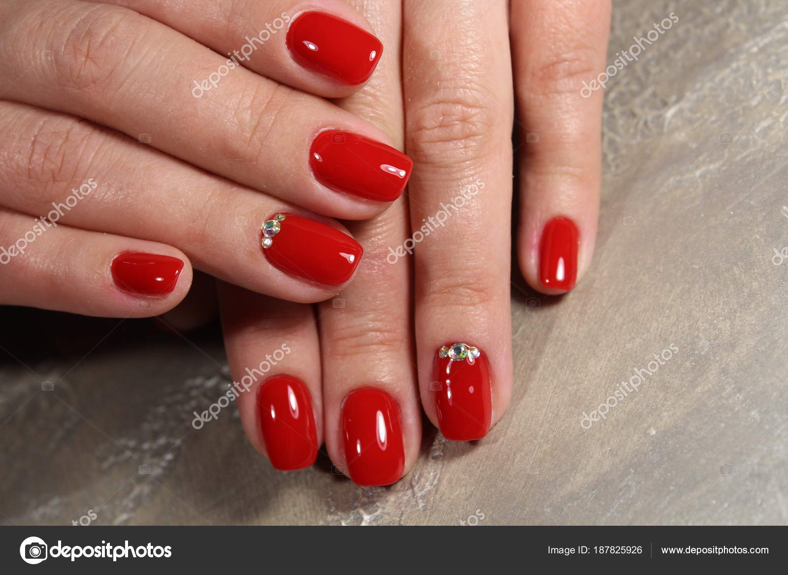 Manicured Nails Colored With Red Nail Polish Stock Photo