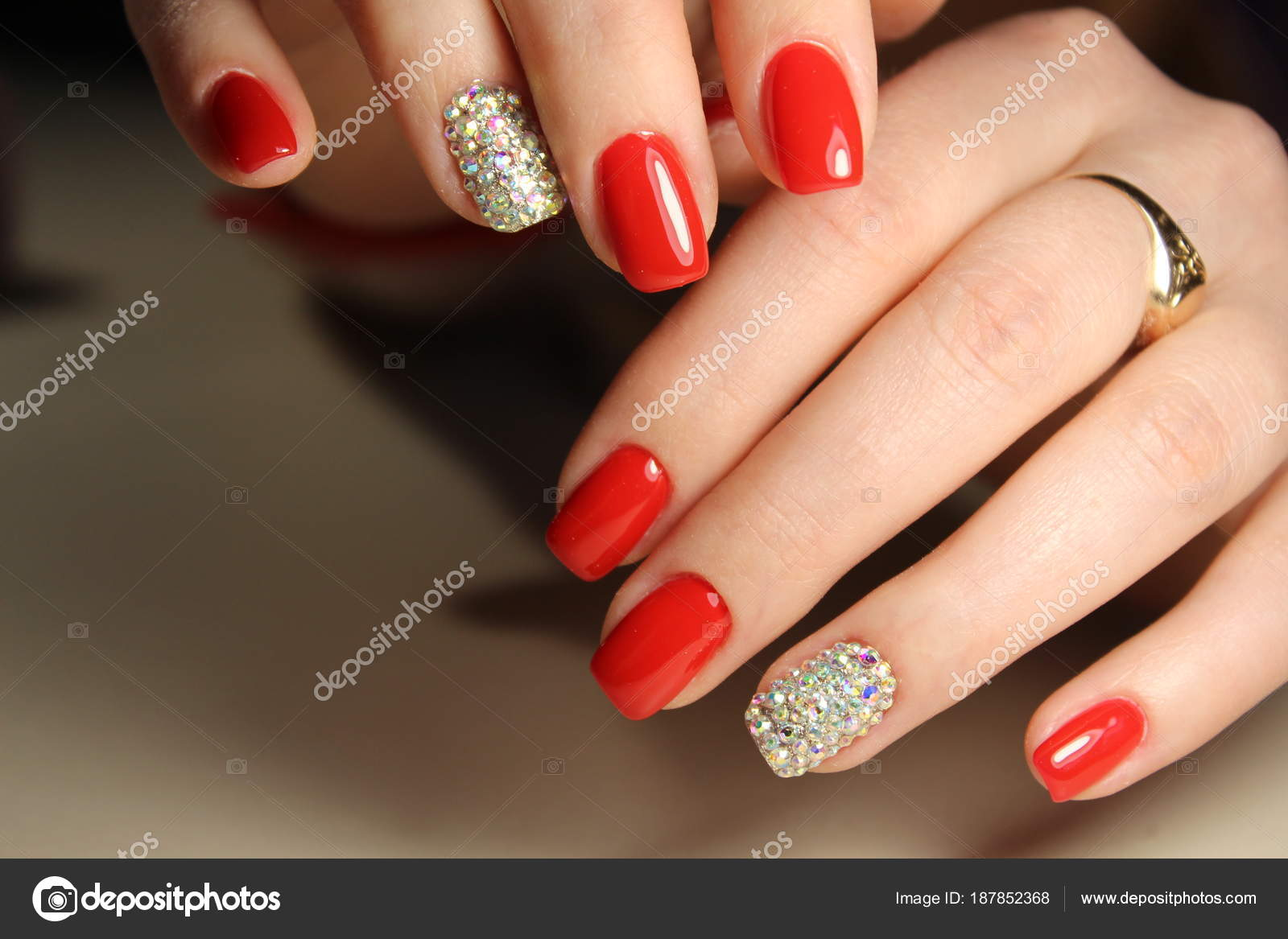 Red Nails With Rhinestones Stock Photo