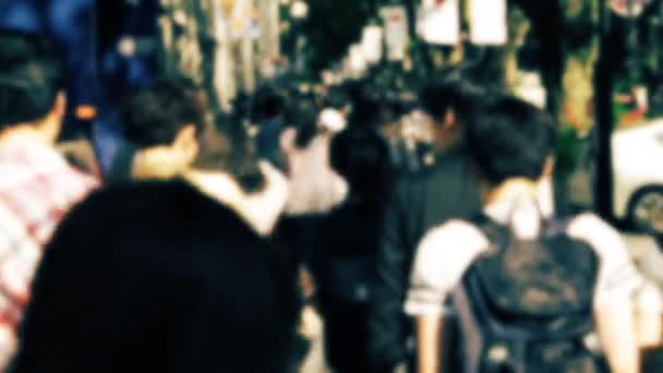 Tokyo- Street view with walking people. Harajuku. Slow motion, defocused look.