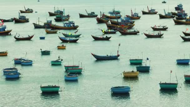 video of many fishing boats floating in sea water
