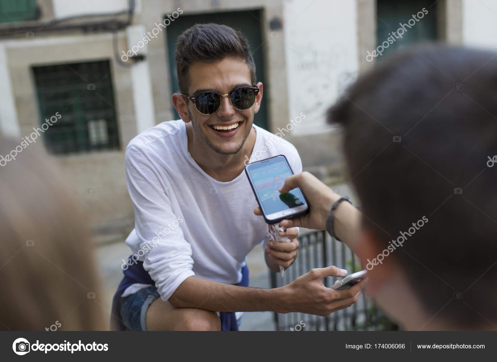 23acab81ba61 Youth Group Mobile Phone Street — Stock Photo © carballo  174006066