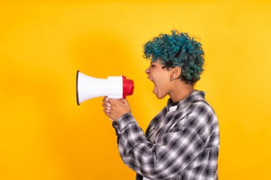 girl with megaphone isolated on color background