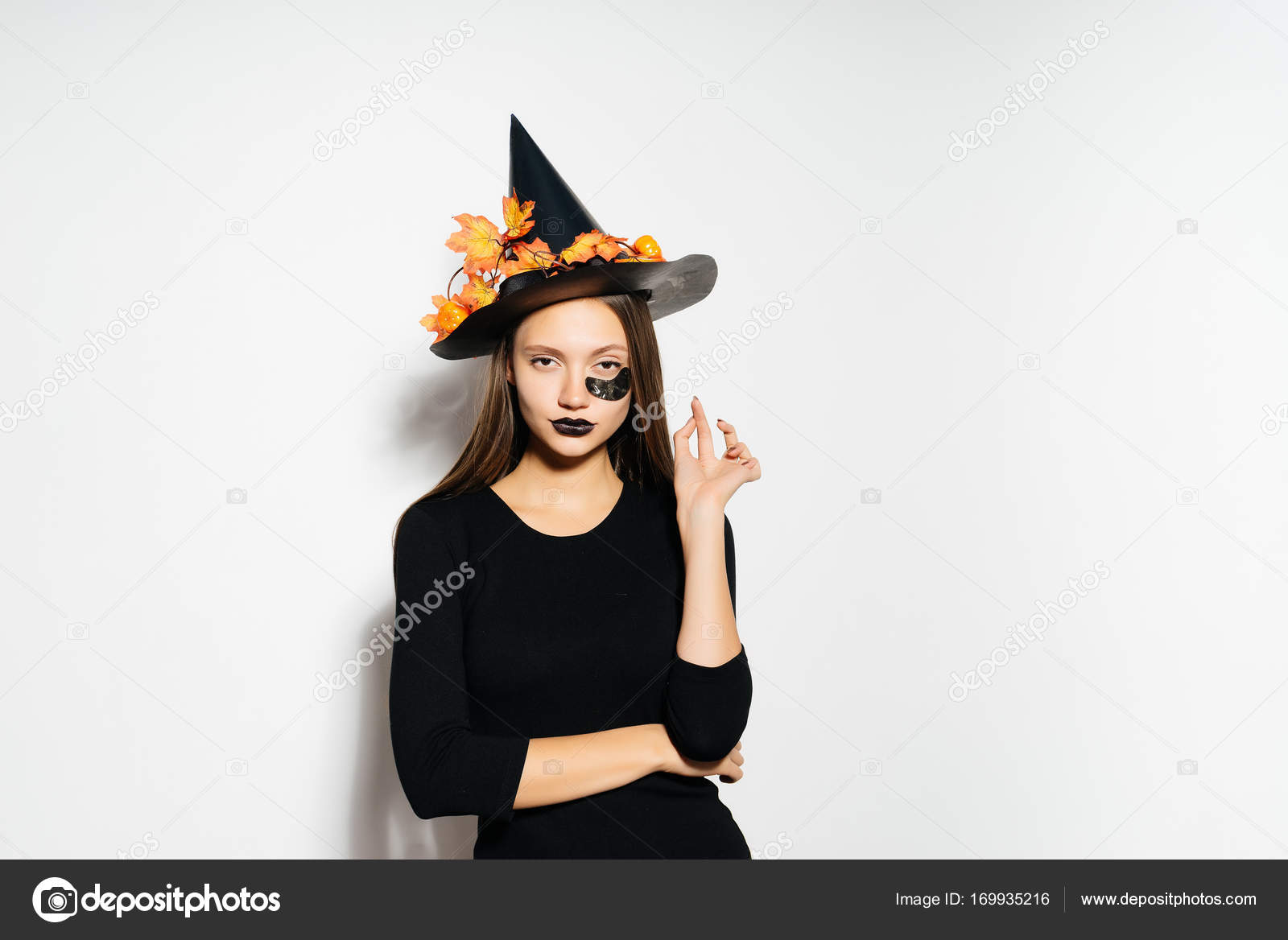A beautiful girl in a Halloween costume and a black witch hat looks cool with black lipstick u2014 Photo by mne_len  sc 1 st  Depositphotos & A beautiful girl in a Halloween costume and a black witch hat looks ...