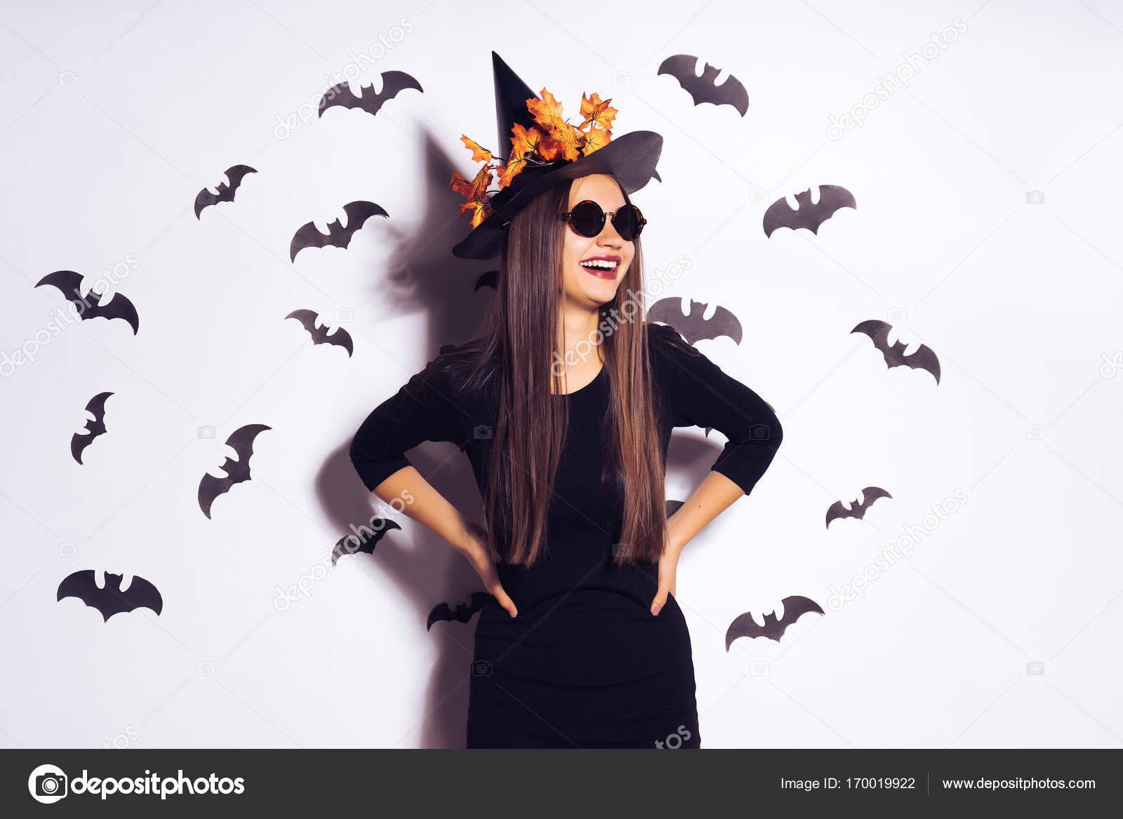 Young Smiling Sexy Girl In The Image Of A Witch In Halloween On The