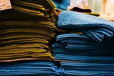lie a lot of soft green and blue bath mats
