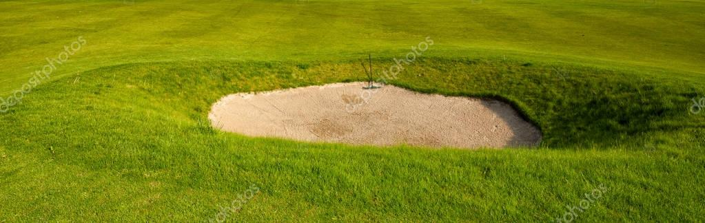 Sand bunker on the golf field
