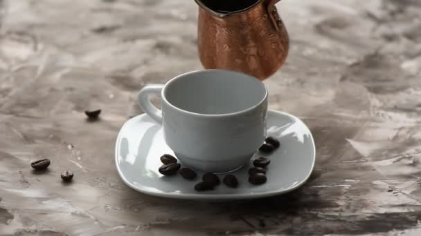 Close up. Pouring black aromatic coffee from cezve.