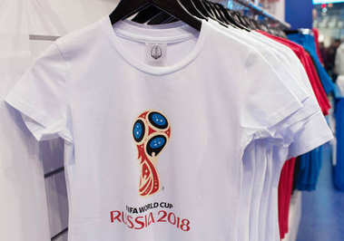 14 December 2017 Moscow, Russia, Symbols of the World Cup 2018 on T-shirts in the official store.